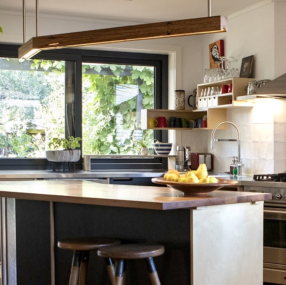 Plywood Pezzo and black Paperock custom kitchen.